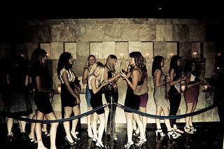 line of girls before nightclub enter