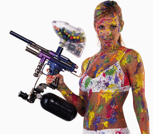 girl covered with painball paint shot