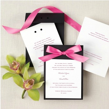 cute wedding invitation with a pink bow