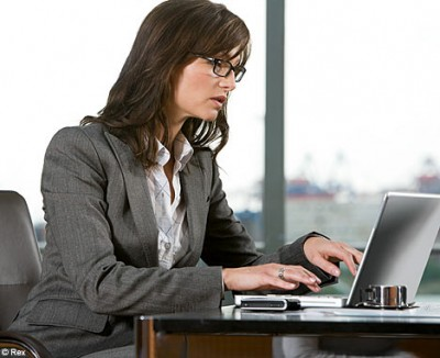 working woman in office in a suit